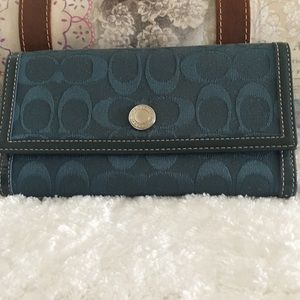 Coach teal color wallet .